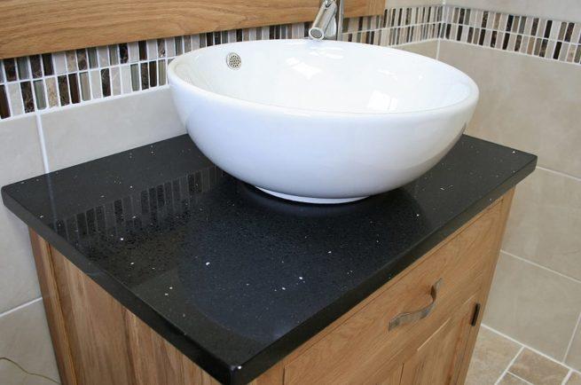 Side View of Round Curved White Ceramic Basin on Black Quartz Topped Oak Vanity Unit