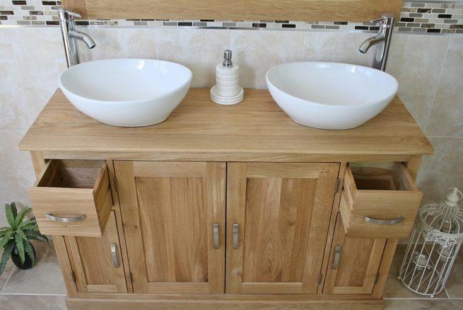 White Oval Ceramic Basins on Oak Topped Bathroom Vanity Unit Showing Opened Drawers
