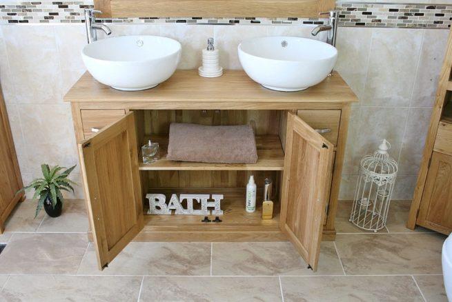 Round Ceramic White Basins on Oak Top Vanity Showing Storage Space