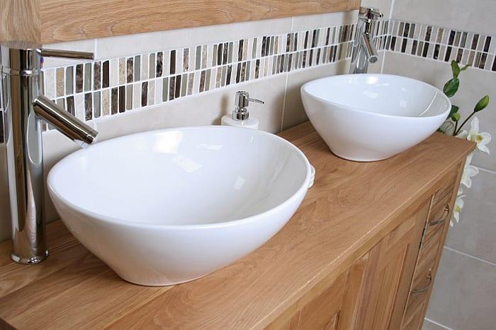 Close-up of Two Oval White Ceramic Basins on Big Oak Top Vanity Unit