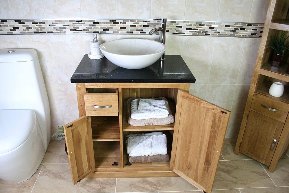 Open Black Quartz Top Vanity Unit with Oval White Ceramic Basin Showing Storage