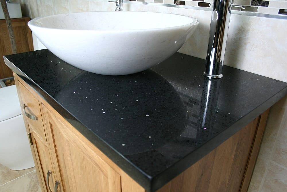 Closeup on Black Quartz Top Vanity Unit and White Oval Ceramic Basin