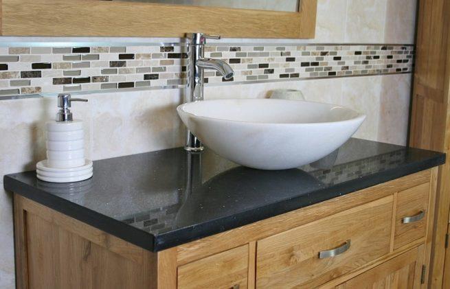 Close Up Side View of Black Quartz Top Vanity Unit & White Marble Basin