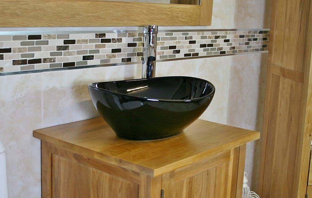 Oval Black Ceramic Basin & Tap Set on Oak Vanity Unit - Side View